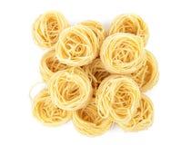 Italian pasta tagliatelle nest isolated on white background Royalty Free Stock Image