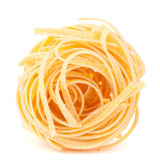Italian pasta tagliatelle nest isolated on white background Stock Images