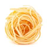 Italian pasta tagliatelle nest isolated on white background Stock Images