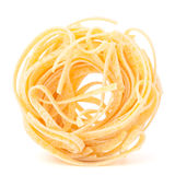 Italian pasta tagliatelle nest isolated on white background Royalty Free Stock Photos