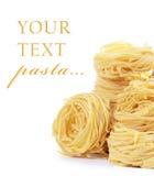 Italian pasta tagliatelle nest on white background Stock Photos