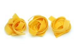 Italian pasta tagliatelle uncooked Stock Image