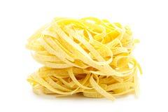 Pasta. Italian pasta tagliatelle  on white background Stock Images