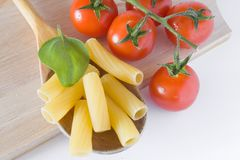 Italian pasta tomato and basil Royalty Free Stock Images