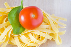 Italian pasta tomato and basil Stock Images