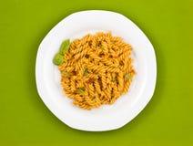 Italian pasta with tomato sauce and basil. Royalty Free Stock Photo