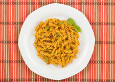 Italian pasta, with tomato sauce and basil. Stock Images