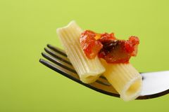 Italian pasta with tomato sauce on fork Royalty Free Stock Photo