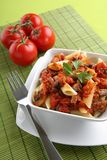 Italian pasta with tomato sauce and parmesan Stock Photo