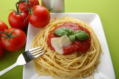 Italian pasta with tomato sauce and parmesan. Stock Photo