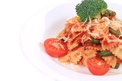 Italian pasta with tomato sauce and parmesan. Stock Photos
