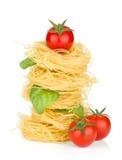 Italian pasta, tomatoes and basil Royalty Free Stock Photography