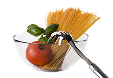 Italian pasta, tomatoes and basil Stock Images