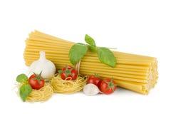 Italian pasta, tomatoes, basil and garlic Stock Photo