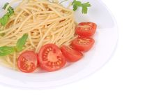 Italian pasta with tomatoes and basil. Stock Images