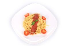 Italian pasta with tomatoes and basil. Stock Photography