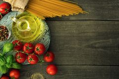 Italian pasta with tomatoes, basil and oil, top view stock image
