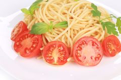 Italian pasta with tomatoes and basil. Royalty Free Stock Photos