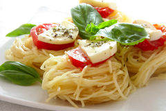 Italian pasta with tomatoes and cheese close up Stock Photo