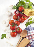 Italian Pasta with tomatoes, garlic, olive oil and italian parsley Stock Photo