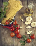 Italian Pasta with tomatoes, garlic, olive oil and italian parsley Royalty Free Stock Photo