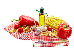 Italian Pasta with tomatoes, garlic, pepper,olive oil  on a whit Stock Photos