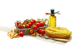 Italian Pasta with tomatoes, garlic, pepper,olive oil  on a whit Stock Photo