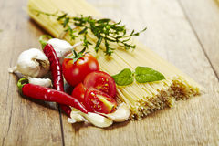 Italian pasta with tomatoes, garlic and red chilli pepper Royalty Free Stock Photography