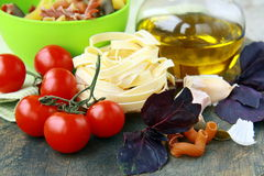 Italian Pasta with tomatoes, olive oil and basil Stock Photo