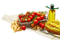 Italian Pasta with tomatoes, olive oil  on a white background is Stock Images