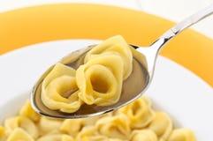Italian pasta ,tortellini in broth, closeup Royalty Free Stock Photo
