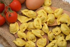 Italian pasta tortellini with eggs. Italian fresh pasta tortellini food Royalty Free Stock Photography