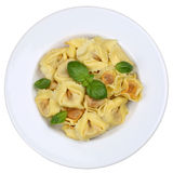 Italian Pasta Tortellini noodles meal with basil isolated Stock Images
