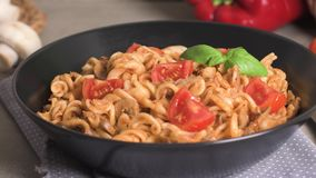 Italian pasta with tuna and basil. Fresh pasta with tuna and tomato sauce on old wooden background stock video