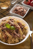 Italian pasta with tuna, black peppers and tomatoes Stock Photos