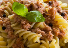 Italian pasta with tuna, black peppers and tomatoes Stock Image
