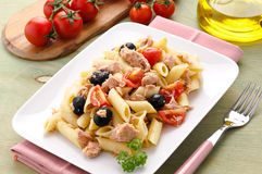 Italian pasta with tuna, olives and tomatoes Royalty Free Stock Photos