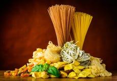 Italian Pasta Types. Different Types of Italian Pasta. Spaghetti, Tagliatelle, ravioli and Tortellini Stock Photos