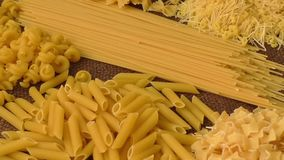 Italian pasta. Variety of types and shapes of Italian pasta stock footage
