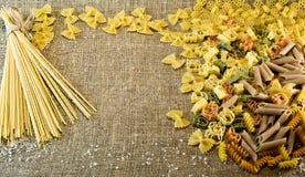 Italian pasta. Variety of types and shapes of dry Italian pasta Stock Photography