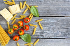 Italian pasta with vegetables, mussels and cheese on the boards Royalty Free Stock Images