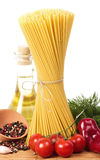 Italian pasta with vegetables, olive oil and spices Stock Images