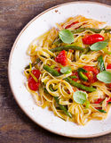 Italian pasta with vegetables on  wooden board. Royalty Free Stock Image