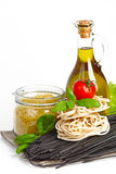 Italian Pasta with vegetables in wooden plate isolated on white. Royalty Free Stock Image