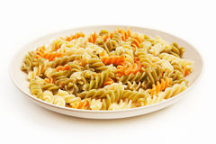 Italian pasta on white plate Royalty Free Stock Images
