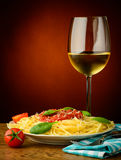 Italian pasta and white wine stock images