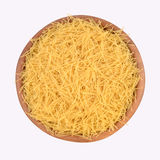 Italian pasta in a wooden bowl Royalty Free Stock Image