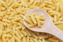 Italian pasta and wooden spoon Stock Image