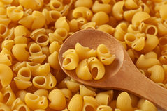 Italian pasta and wooden spoon Royalty Free Stock Images