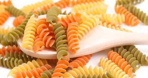 Italian pasta on wooden spoon. Stock Images